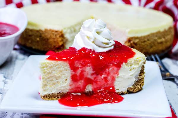 Crack Proof New York Style Cheesecake With Whipped Cream And Fruit Topping.