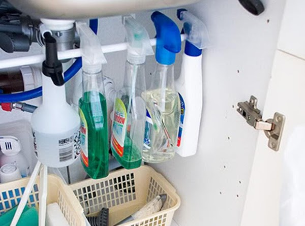 Install a tension rod to hang your spray bottles.