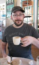 Photo: Enjoying cafe au lait at Cafe Du Monde