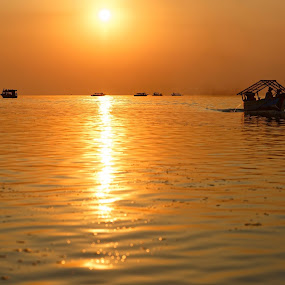 Sunset over Tonlé Sap lake by Claus Dahm - Uncategorized All Uncategorized ( calm, sunset, boats, lake, sun, cambodia,  )