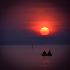 fishing in the sunset by Rinal Dino - Landscapes Sunsets & Sunrises ( work, sunset, sea, landscape, man )