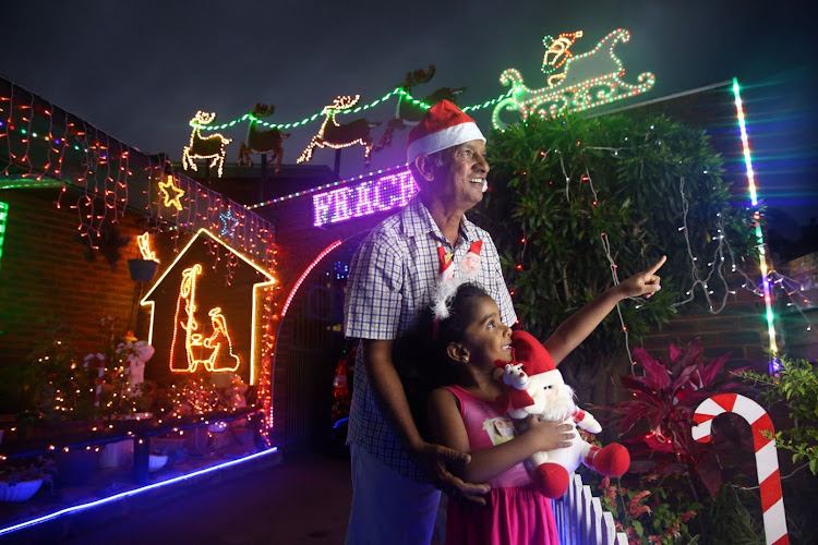 Skyler Pillay, 4, visits her grandfather, Trevor Pillay, in Merewent. Every year he lights up the family home on December 1.