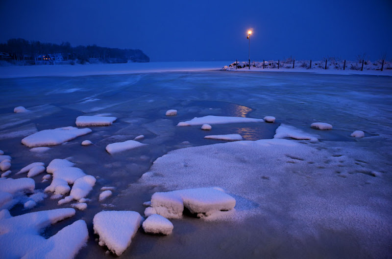 Photo: Melting ice and fresh snow at the boat launch at Warner Park Beach in Madison, Wisconsin.