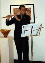 Photo: Award-winning student flutist, Anton Spencer, provides some music to enhance the appreciation of Phil's turned wooden vessels.