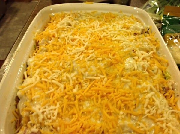 Now pour about half of cheese sauce over ham & cauliflower, then top with...