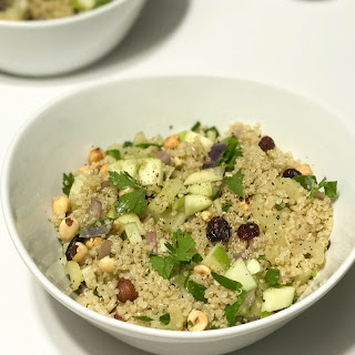 Warm Autumn Quinoa Salad with Hazelnuts, Apple, and Cranberries