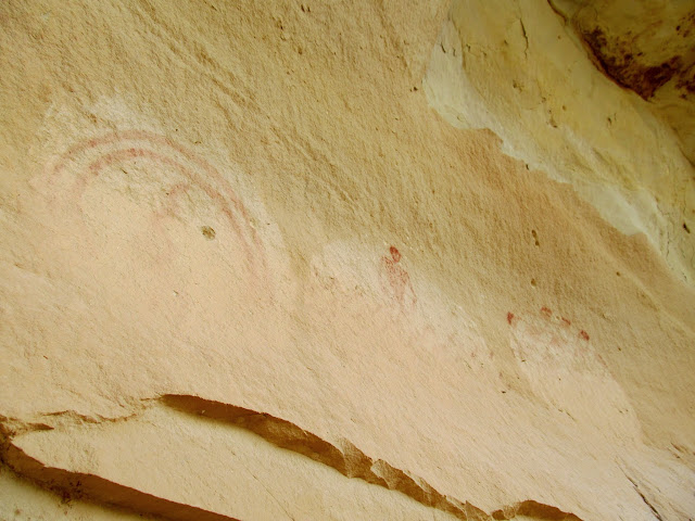 Pictographs covered in mud