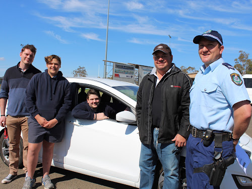 Jesse Druzinec, Oscar Howarth, Roy Orman behind the wheel, Justin Orman, supplier of the vehicle from Max Orman Toyota Narrabri,  Senior Constable George Perrett, Oxley Highway Patrol Unit.