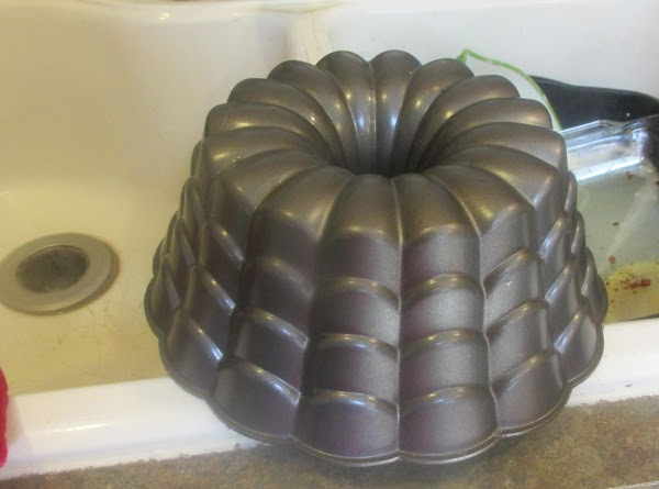 Preheat oven to 325 degrees F. Grease and flour a 12 cup Bundt pan,...