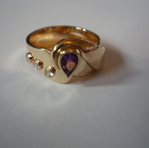 Gold garnet and diamond ring created by Helen Burrell