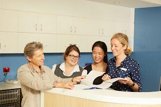 Photo: Ms Heather Cleland and ward nurses looking at case notes Image: Ben Capp