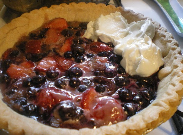 Gently drop spoonfuls of cheesecake mixture on top of berry layer, beginning with the...