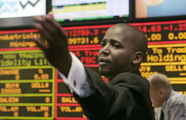 A broker makes a bid at a morning trading session of the Zimbabwe Stock Exchange in the capital Harare. Picture: REUTERS