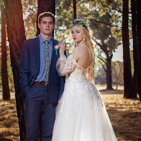 In the woods by Carel Van Vuuren - People Fashion ( face, fashion, girl, nature, sunset, dress, white, suit, trees, forest, couple, man )