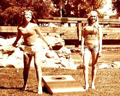 Vintage photo of young women playing cornhole in the 60's