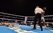 Siboniso Gonya is knocked out by Zolani Tete with his first punch after only a few seconds during their WBO Bantamweight Championship.