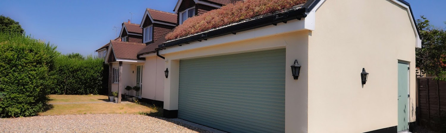 home side extension, white painted garage