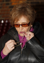 Photo: Joan Paolino kisses her rosary before a  Mass dedicated to people affected by Hurricane Sandy at St. Charles Church in New York's Staten Island Nov. 7. Three members of the parish were killed in the monster storm a week ago. (CNS photo/Bob Roller) (Nov. 8, 2012)