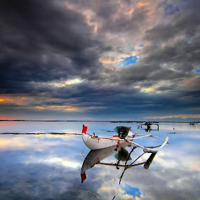 Tuban Reflection by Calvin Go - Transportation Boats ( bali, reflection, indonesia, dramatic, cloud, beach, sunrise, boat )