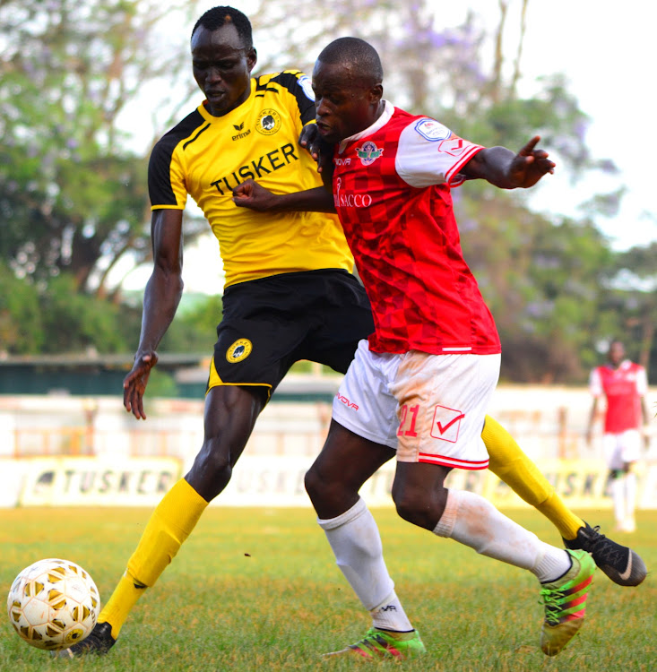 Tusker's David Majak in past action against Western Stima's Henry Onyango.