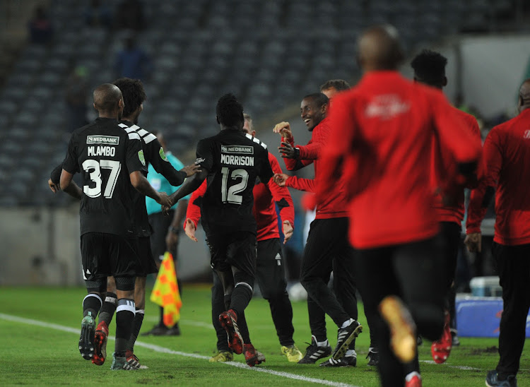 Orlando Pirates' striker Bernard Morrison celebrates with the bench and teammates after scoring a goal during the Nedbank Cup Last 32 match against Ajax Cape Town on 10 February 2018 at Orlando Stadium.