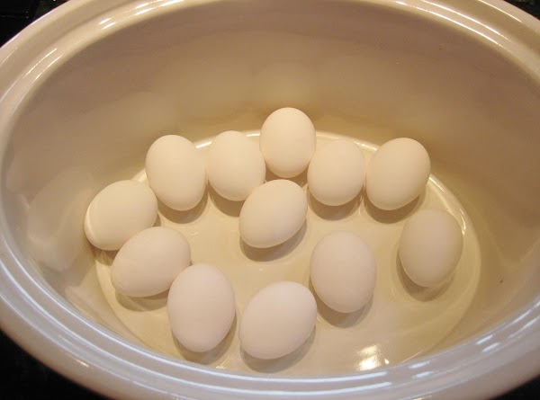 Place eggs in slow cooker in single layer.