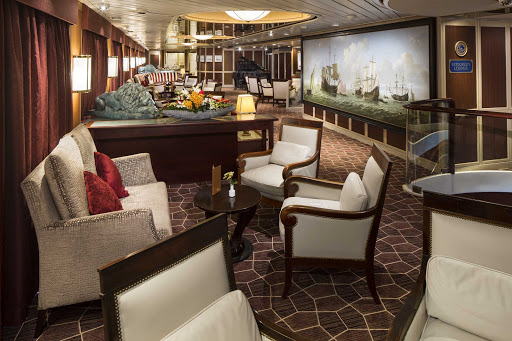 The Explorer's Lounge on deck 4 of Prinsendam features a large, comfortable seating area for passengers.