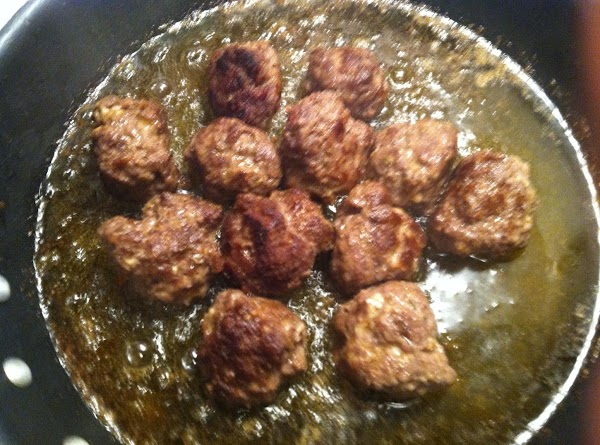 cook meatballs evenly on all sides. (use a lid or cover when cooking to...