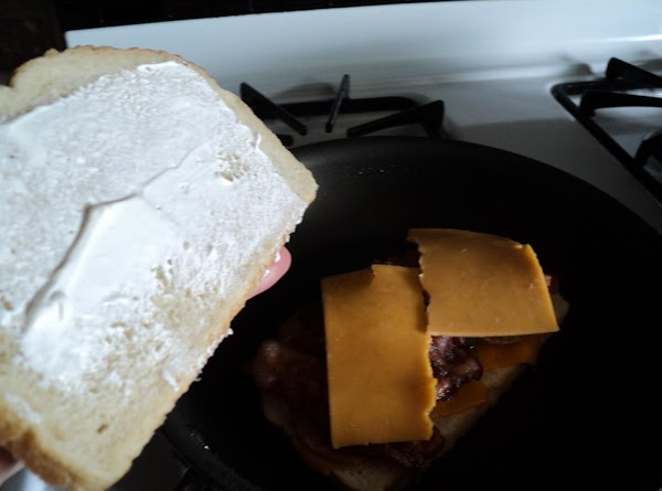 Generously butter slices of bread on the outside of each piece only..place 1 T....