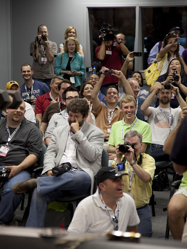 Participants of the STS-133 Tweetup snap photos and watch as a dexterous humanoid astronaut helper.