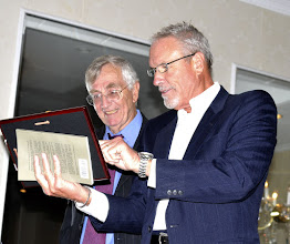 Photo: Barry Ladendorf shows Hersh the plaque of appreciation from VFP