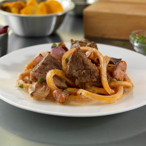 Milk-Braised Pork Shoulder Stroganoff with Butternut Squash Noodles, Chanterelle Mushrooms and Thyme-Brown Butter Sauce