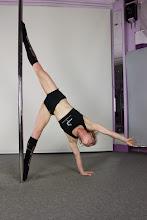 Photo: Vertical Pole Gymnastics - Straddle Stretch One Handed