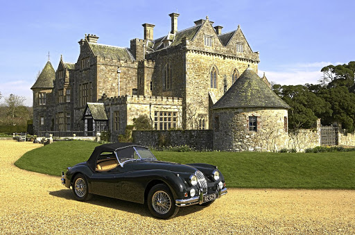 A 1954 Jaguar outside Palace House, Beaulieu, can be nothing more than a dream for millennials.