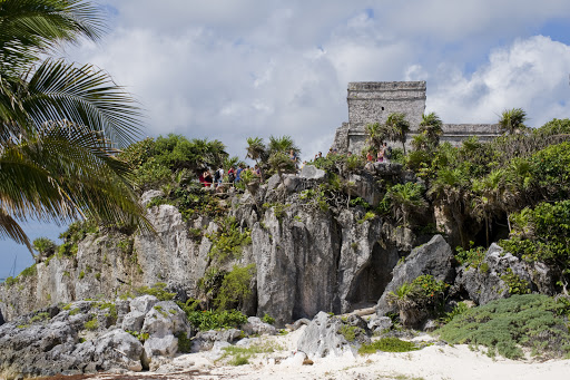 Roaming iguanas compete with ancient temples for attention at the Maya ruins of Tulum.