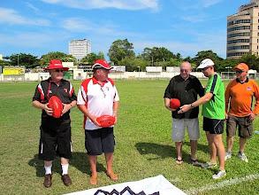 Photo: The three veterans prepare to present the match balls to field umpire, Adam MacDonald. Photo, Dani Moger.