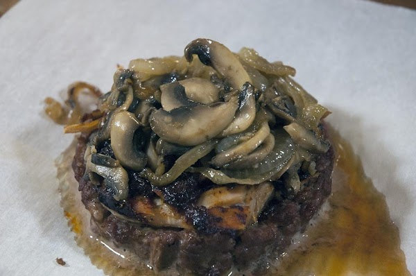 After 30 minutes add half the mushroom/onion mixture to the top of each burger,...