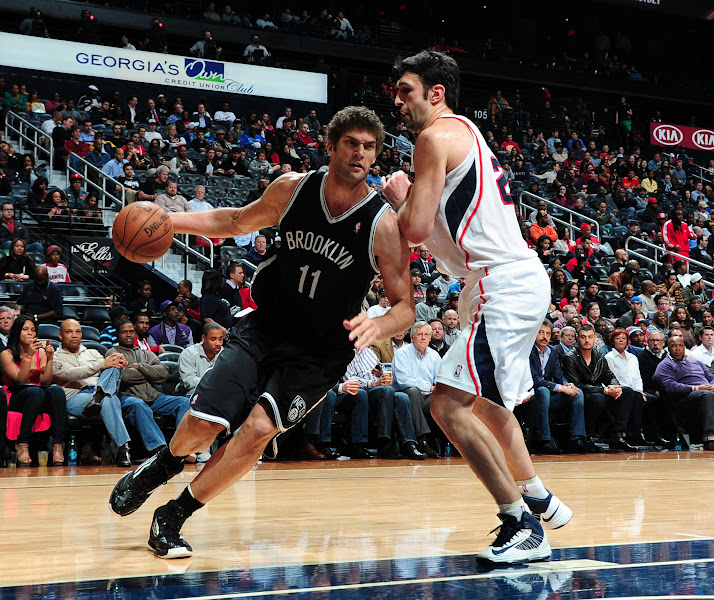 Photo: Brook Lopez #11 of the Brooklyn Nets drives to the basket against Zaza Pachulia #27 of the Atlanta Hawks on January 16, 2013 at Philips Arena in Atlanta, Georgia.