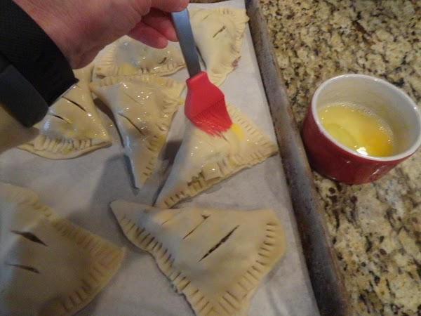Beat egg and brush each empanada with egg wash. Bake in oven 35 minutes....