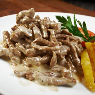 Beef Stroganoff with Straw Potatoes.