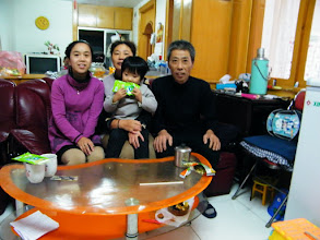Photo: baby's mom, emakingir, with her uncle's family.