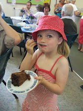 Photo: Kassia one of the Sparklers enjoys a piece of cake!