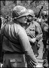 Photo: Lieutenant Colonel Charles Fassinger, highest ranking uniformed officer of Ohio National Guard at Kent State on May 4, 1970. Notice the ammo clip on the shirt of the guard with a gas mask.
