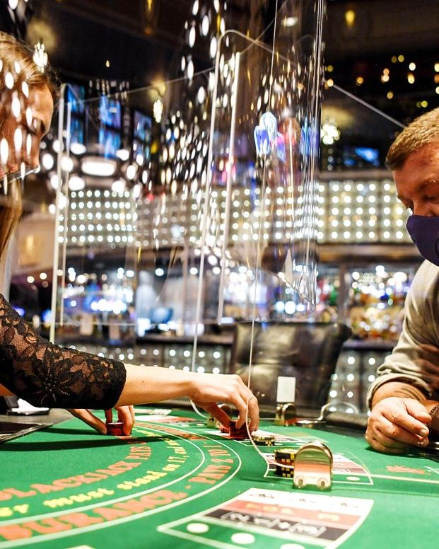 A picture containing indoor, gambling house, person, scene  Description automatically generated