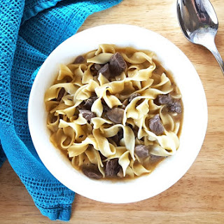 One Pot Beef Stroganoff Soup with Sauteed Mushrooms and Egg Noodles.