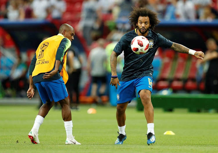 Brazil's Marcelo and Fernandinho during the warm up before the match.