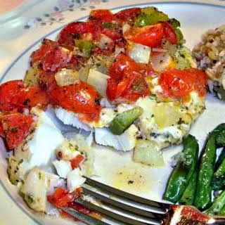 Baked Fish Fillets with Tomatoes, Peppers and Onions.