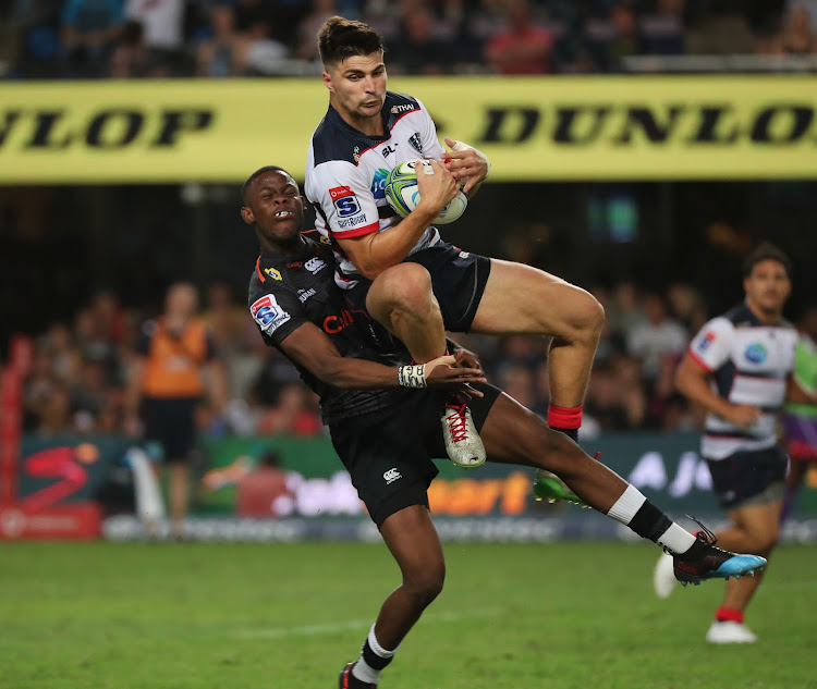 Cell C Sharks fullback Aphelele Fassi tackles Jack Maddocks of the Melbourne Rebels during a Super Rugby encounter at Kings Park Stadium, Durban on March 23 2019.