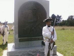 Photo: Al Ward assumes the same pose as the monument on the soldier
