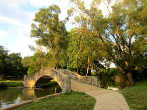 Photo: Late afternoon sun on a stone bridge over a pond at Eastwood Park in Dayton, Ohio.